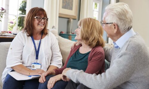 Female Support Worker Visits Senior Couple At Home